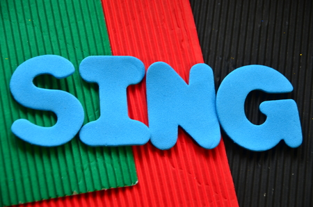 word sing on an abstract background Stock Photo - 104214524
