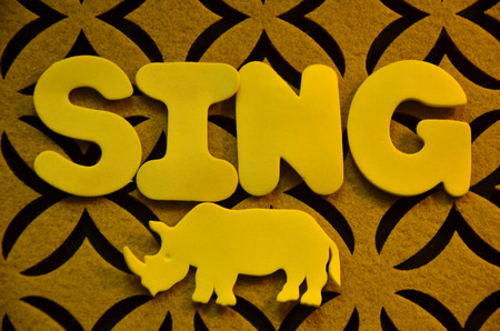 word sing on an abstract background Stock Photo - 104160897