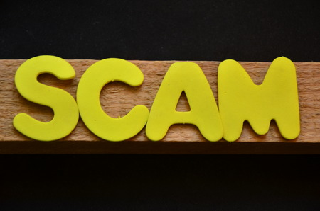 WORD SCAM on an abstract background