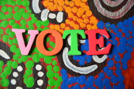 word vote on an abstract background