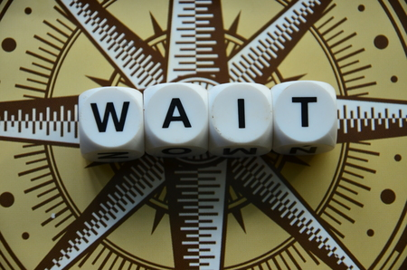 Word wait on an abstractly colored background Stock Photo