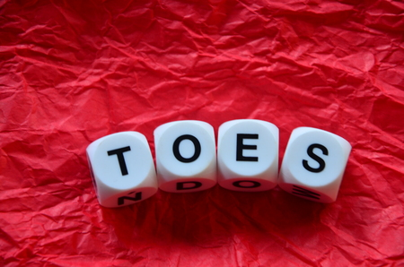 word toes on an abstract background