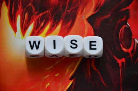 WORD WISE on an abstract background Stock Photo