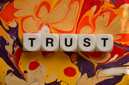 word trust on an abstractly colored background Stock fotó