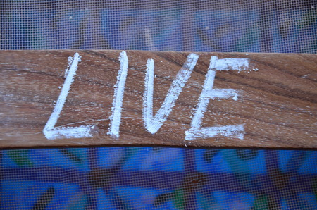 word live on an abstract background