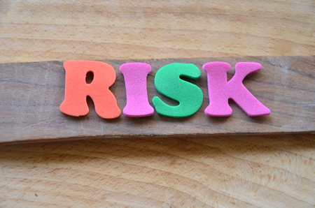 word risk on an abstract background