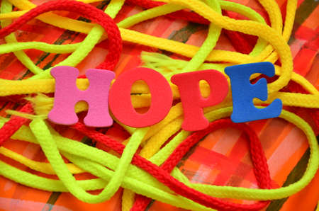 word hope on an abstract background Foto de archivo - 104564132