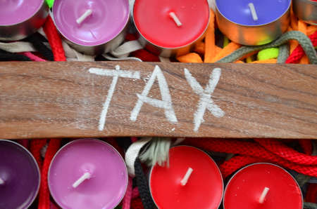 word tax on an abstract background