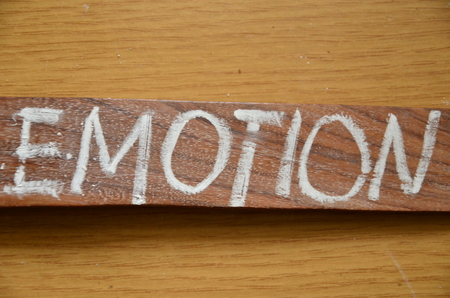 word emotion on an abstract background