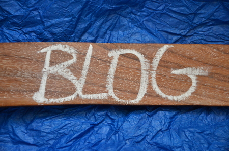 word blog on an blue background