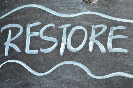 word restore on an abstract background