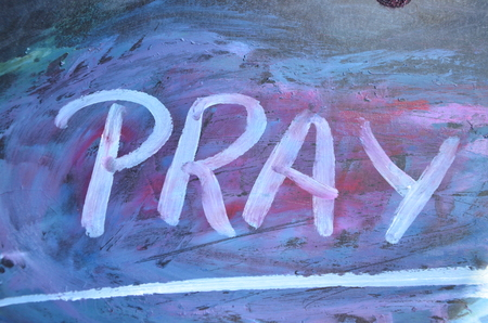 word pray on an abstract background