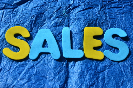 word sales on an abstract blue background