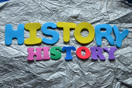 Word HISTORY on an abstract background Imagens