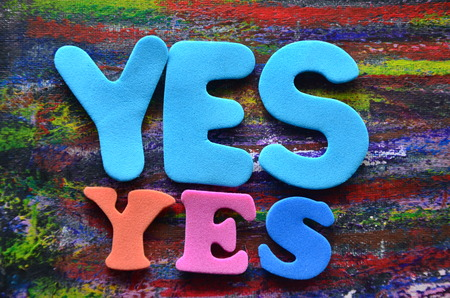 word yes on an abstyract background