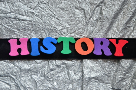 word history on an abstract silver background