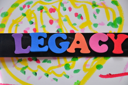 Word legacy on an abstract background