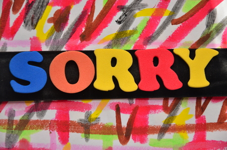 word sorry on an abstract background Stok Fotoğraf