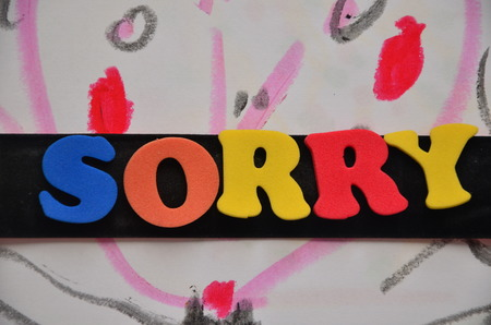 word sorry on an abstract background Archivio Fotografico