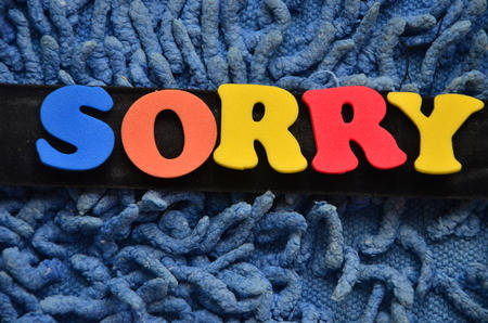 word sorry on an abstract background Standard-Bild