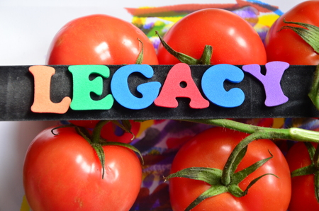 Word legacy with tomatoes in the background