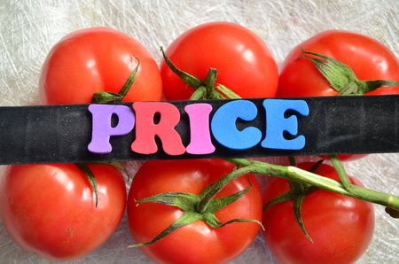 Word price with tomatoes in the background