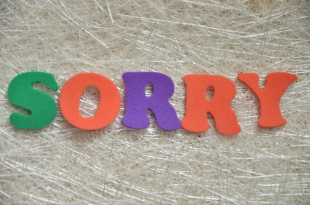 word sorry on an abstract background Stock Photo