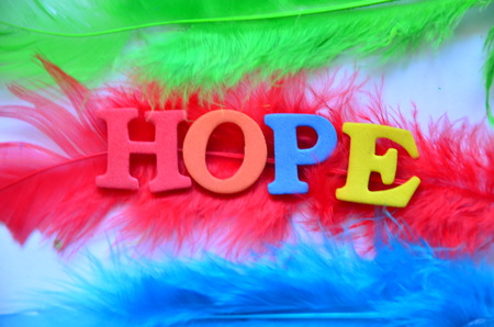 word hope on an abstract background