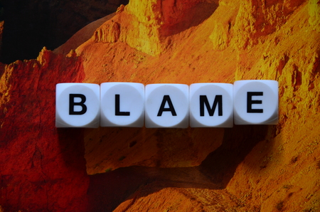 word blame on an abstract background