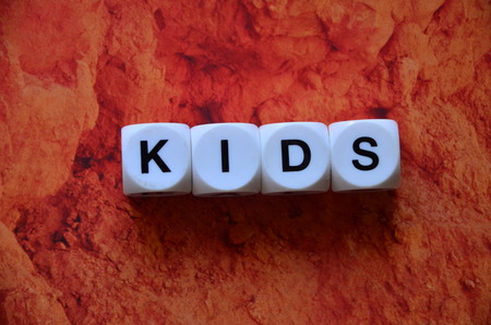 Word kids on an abstract background Stock Photo