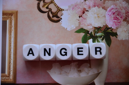 word anger on an abstract background