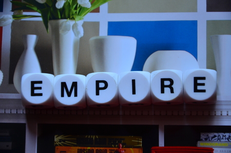 word empire on an abstract background Imagens