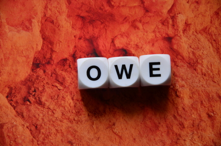 word owe on an abstract background Stock Photo