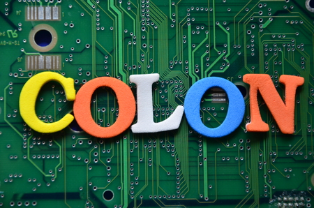 word colon on an abstract background