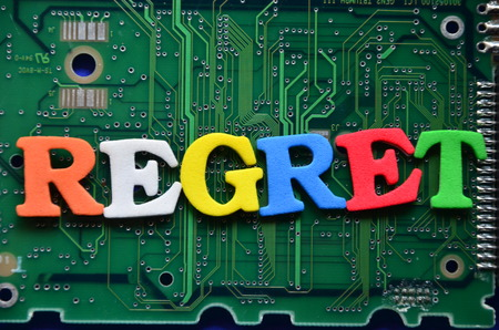 word regret on an abstract background