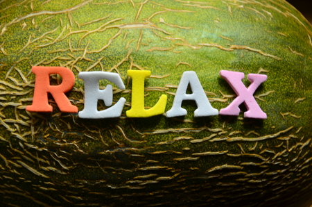 word relax on an abstract background