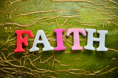 Word FAITH on an abstract background