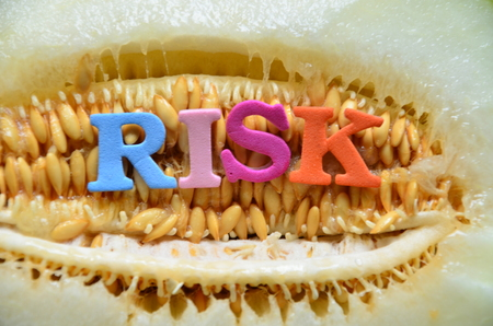 word risk on an abstractb background Stock Photo