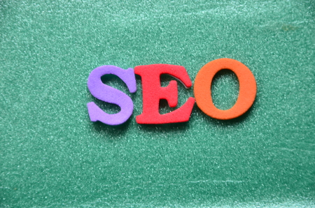 word seo on an abstract background Stock Photo