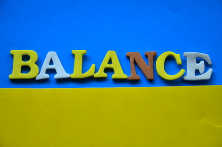 word balance on an abstract background