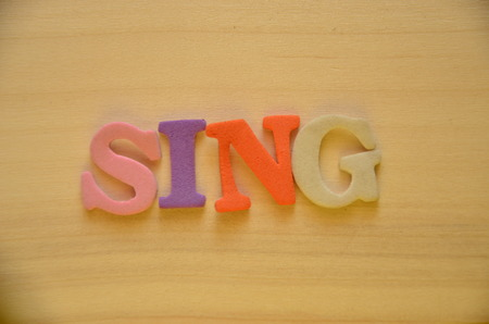 word sing on an abstract background Stock Photo - 106217834