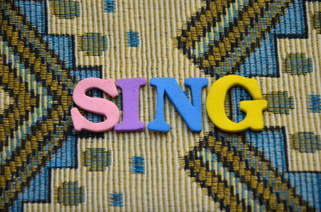 word sing on an abstract background Stock Photo - 106173395