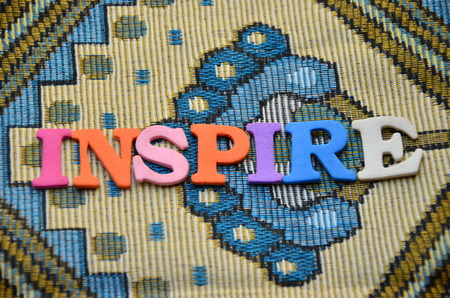 word inspire on an abstract background