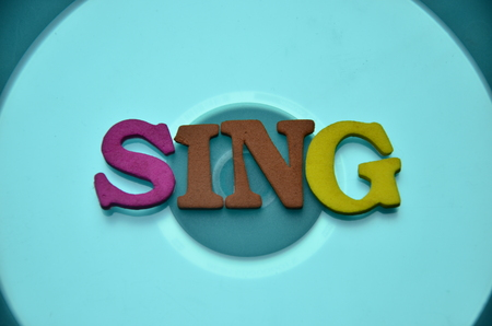 Word sing on an abstract background Stock Photo