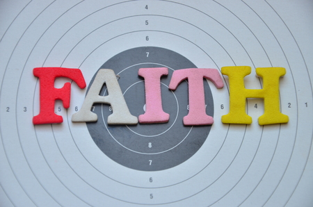 Word faith on an abstract background Stockfoto