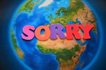 word sorry on an abstract background Imagens