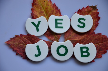 Word YES JOB on an abstract background Stock Photo