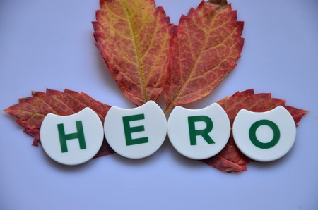 Word HERO n an abstract background Stock Photo