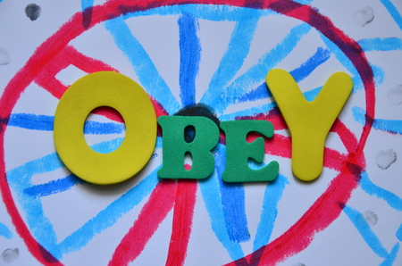 Word obey on an abstract background Foto de archivo - 107127348