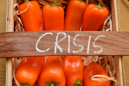 word crisis on an abstract background Stock Photo